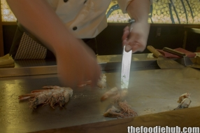 Preparing the prawns with crispy heads