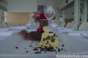 Chocolate pudding chocolate sauce popping chocolate dried berries